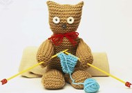 Knitted stuffed teddy bear doll holding knitting needles and 'knitting' blue scarf - Encyclopædia Britannica ImageQuest