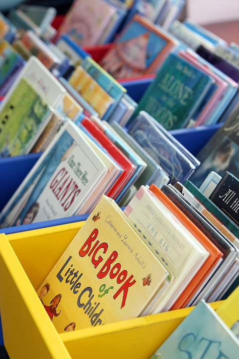 children's books in a bin