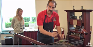 Screenshot from video How to Use a Colonial Era Printing Press