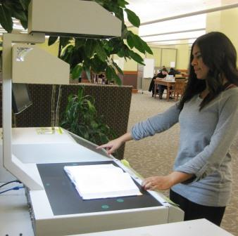 image of a person using a scanner