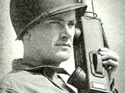 Black and White image of a solider with an old mobile phone