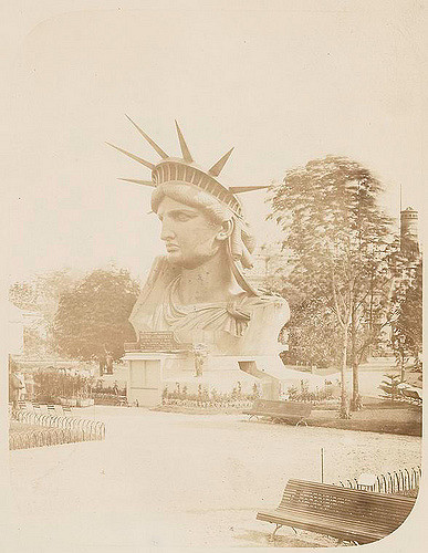 [Head of the Statue of Liberty on display in a park in Paris..