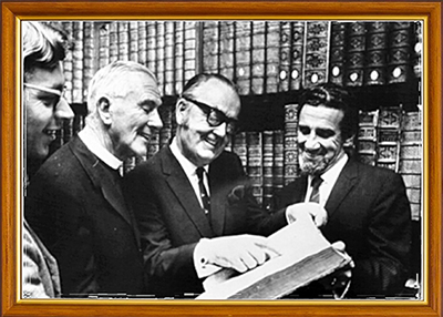 The first transfer of rare books of St. John's College Library Morpeth, to the University Library in 1973. The Rev. Ray Williamson, Bishop Housden, Vice- Chancellor Auchmuty and the University Librarian Edward Flowers.