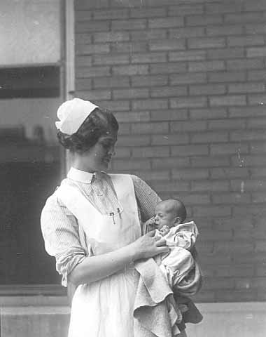 Nurse with abandoned child in unknown hospital.