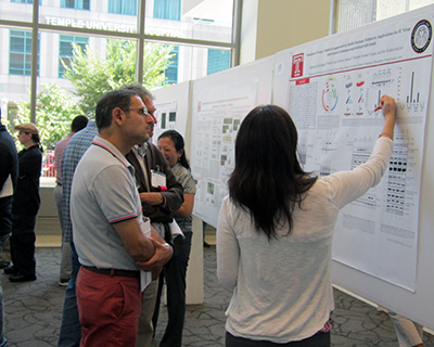 Temple student presents their poster at a conference.