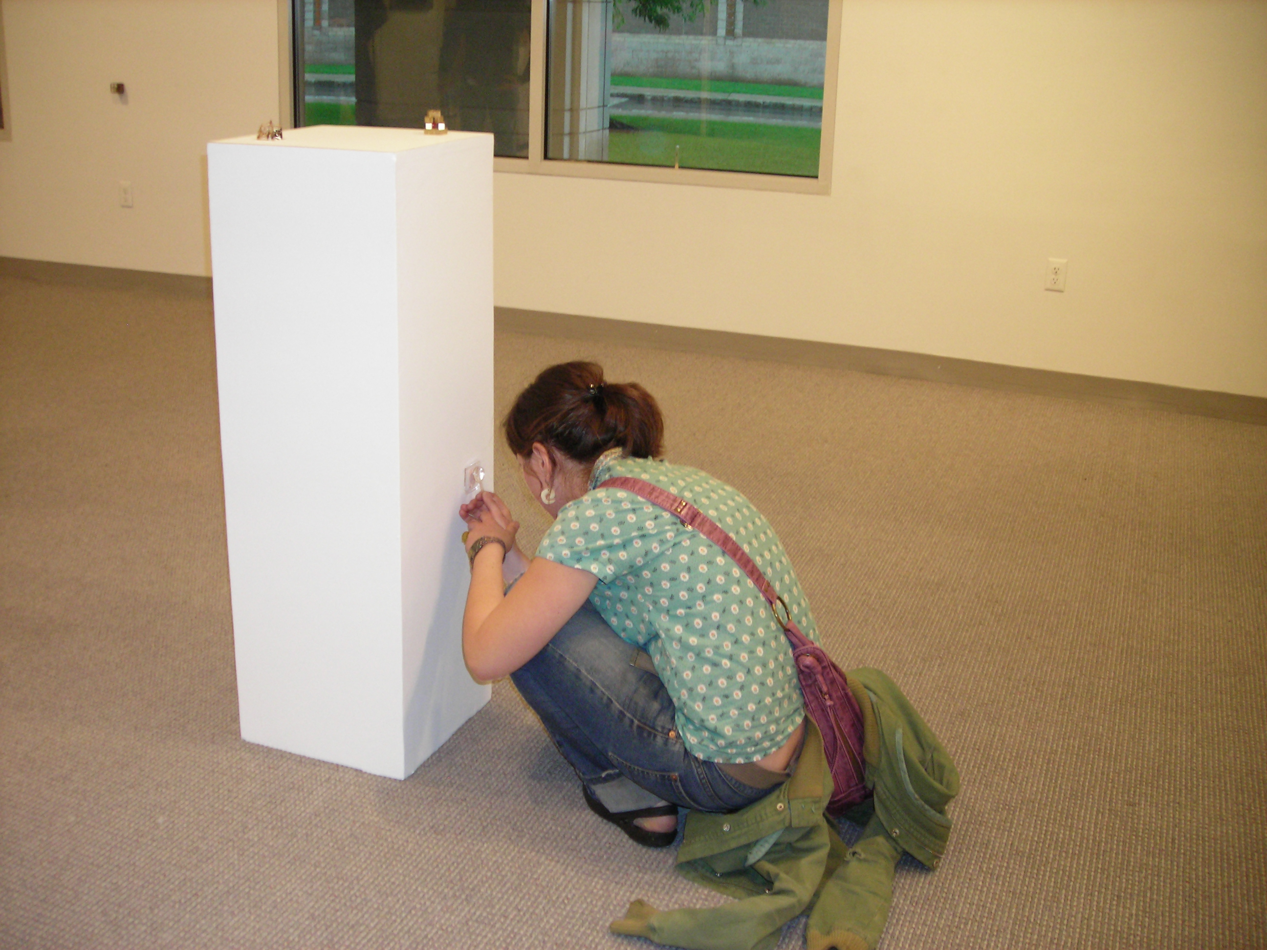 student working on exhibit set up