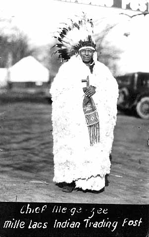 Chief Me-gee-see wearing rabbit robe, Mille Lacs Trading Post, c. 1925