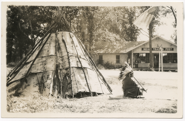 Ojibway man seated by tipi at Mille Lacs Trading Post, c. 1935
