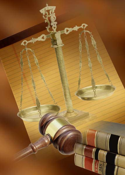 items associated with the legal world: scales, gavel, law books, and a legal pad