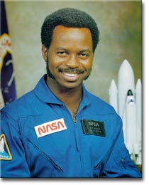 Ronald McNair in his official NASA photo, wearing ablue NASA jumpsuit.