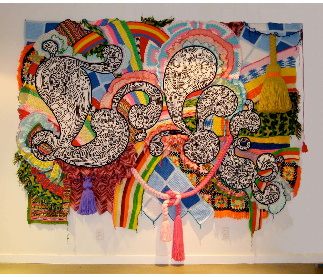 LOVE , 2007, found afghans acrylic yarn, and pom-poms on canvas, 96 x 114 x 10 inches