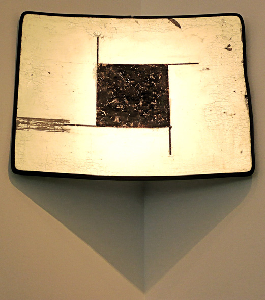 Eye of Horus, 2010, dirt from the grave of Bobby Fischer on found home video projection screen, 36 X 48""