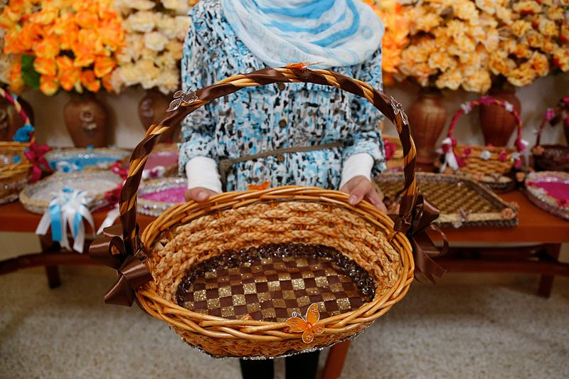Decorative image of a weaved basket, made by a young Syrian refugee