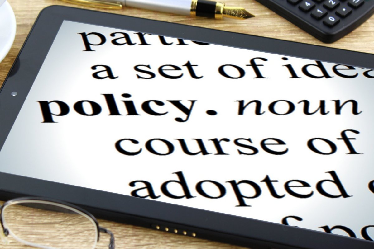 Decorative image of eBook reader with the word policy highlighted