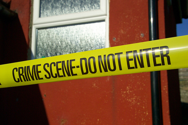 Picture of a door with crime scene tape across it