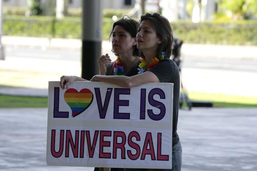 "Sign wavers at the Capitol: ""Love is universal."""