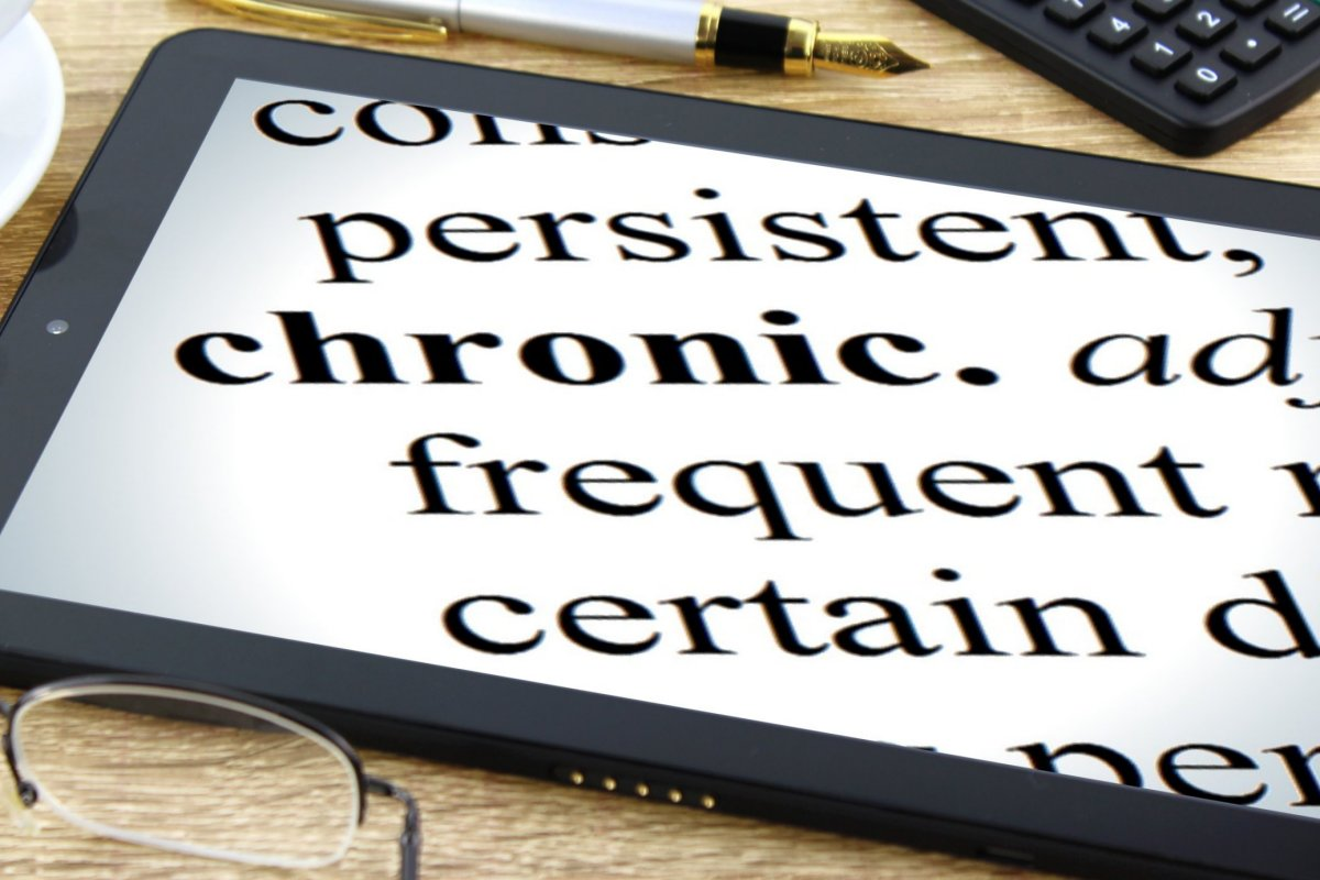 "A tablet with the word ""chronic"" in bold, surrounded by synonyms like ""persistent"""