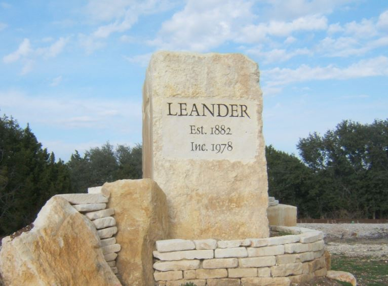 Stone carved with Leander TX dates