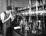Student working in chemistry laboratory, 1935.