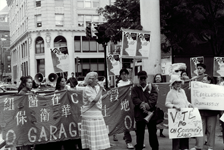 A rally held against the building of a garage on Parcel C in Boston, 1993. Photograph from the Chinese Progressive Association Collection.