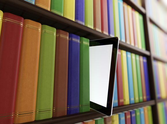 Taking an iPad from a library bookshelf