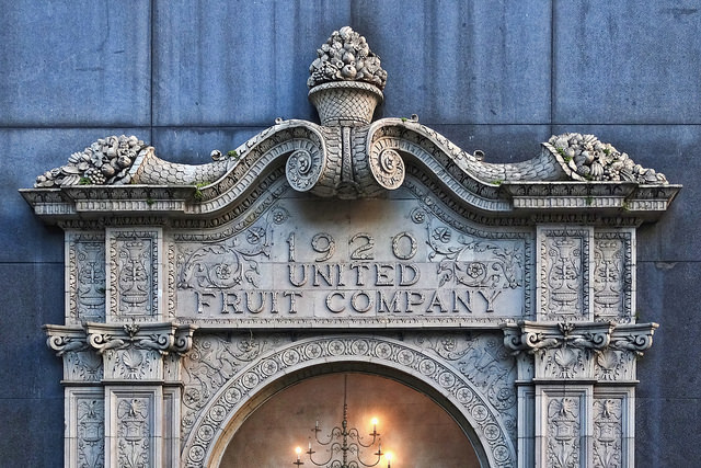 "decorative image of door threshold that says ""1920: United Fruit Company"""