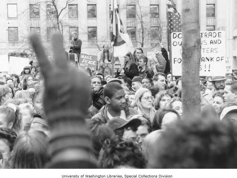 photo of protesters with signs and flags at a Gulf War protest in Seattle, Jan 15, 1990