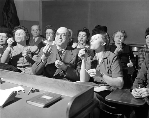 "English language students from other countries learn to pronounce ""th"" as in ""My other brother sent the Christmas wreathe"" in New York, Jan. 14, 1943. (AP Photo/Bob Wands)"