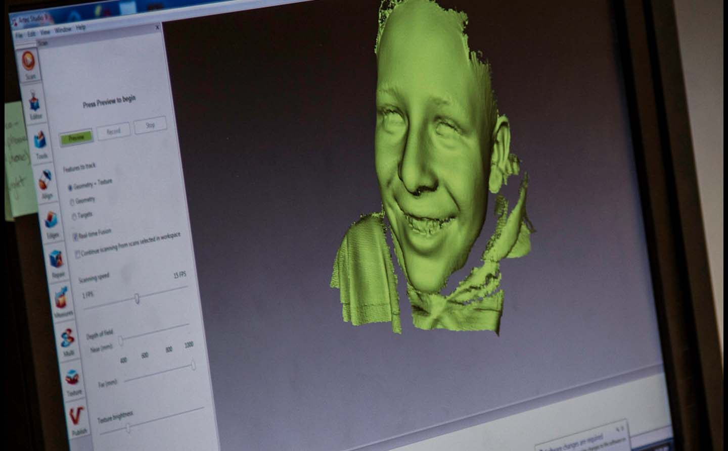 Screenview of a child face's being 3D scanned at DeLaMare Library