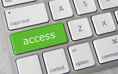 "the word ""access"" in white letters on a green key that is part of a larger keyboard"