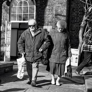 elderly couple walking outdoors
