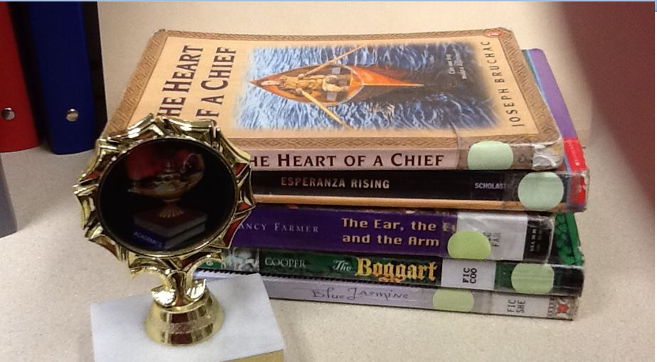 Photo of books and trophy