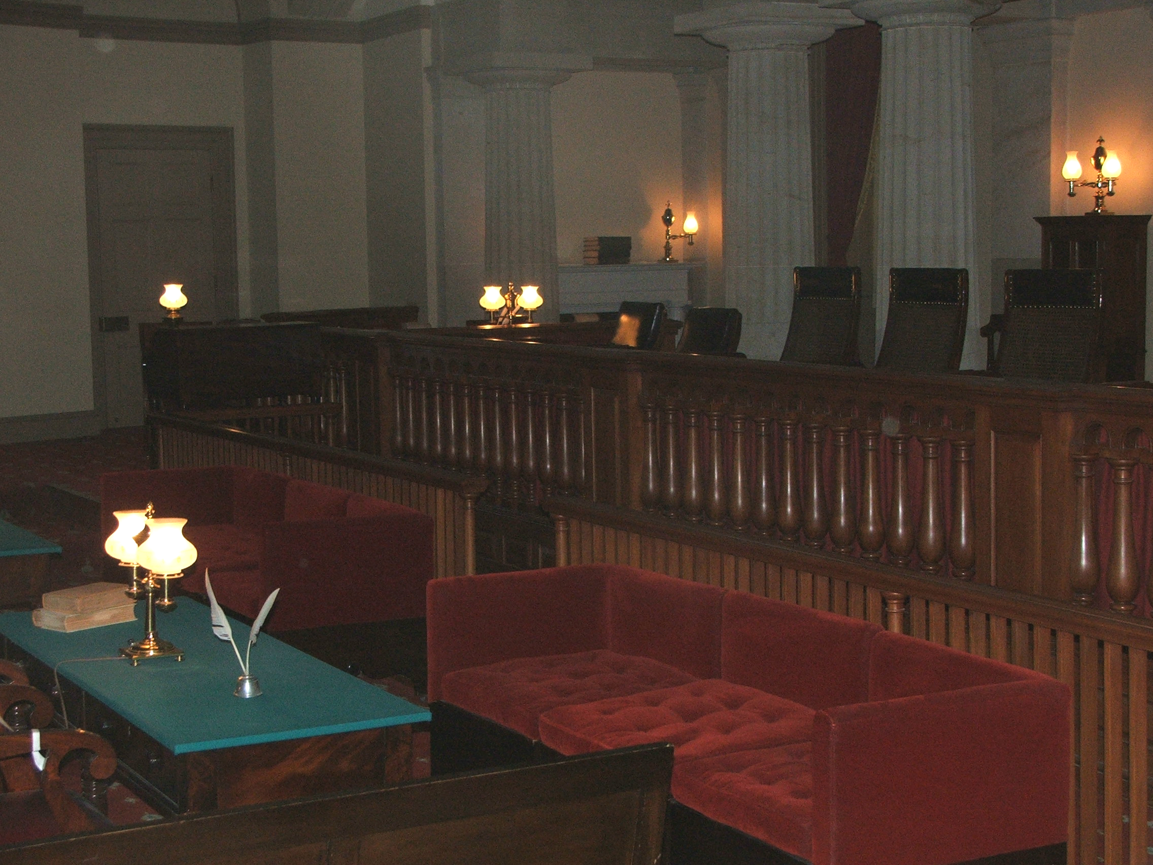 Quill pens and old-fashioned lanterns lend a historical air to the old Supreme Court Chamber.