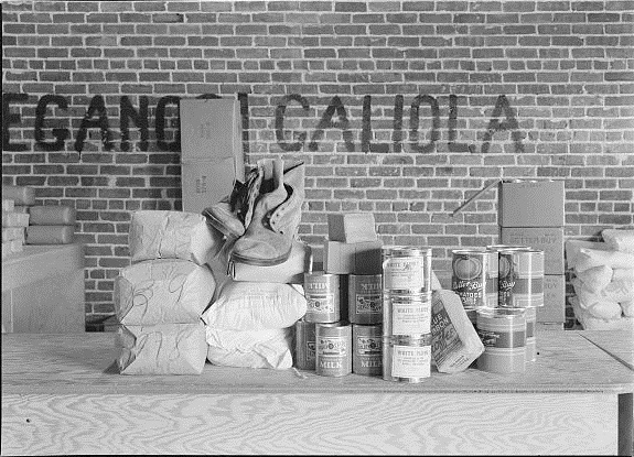 The commodities on the counter represent two weeks allotment for four people.  Photograph made in Farm Security Administration (FSA) distributing station for emergency grants of food and clothing to  destitute agricultural workers. Bakersfield, California