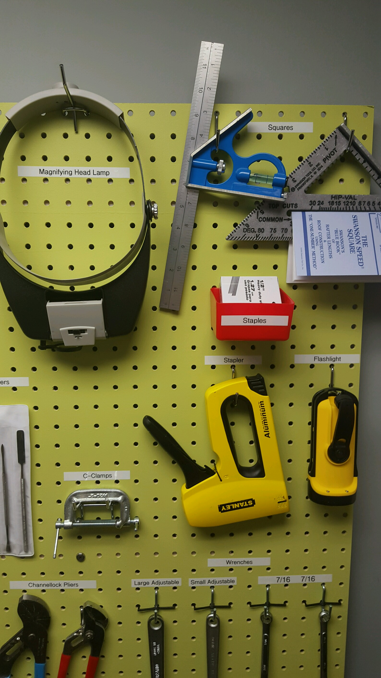 Magnifying Head Lamp, C clamps, Squares, Staple Gun, and Flashlight