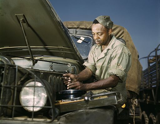 Portrait of an African American Soldier doing mechanical work