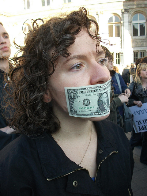 Occupy: Protest photo of young woman in Paris. Daniel Finnan. 2010 Jun.