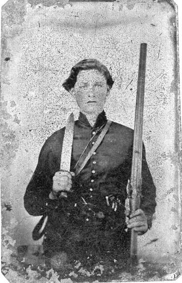 Photo: Young man holding a rifle and its bayonet