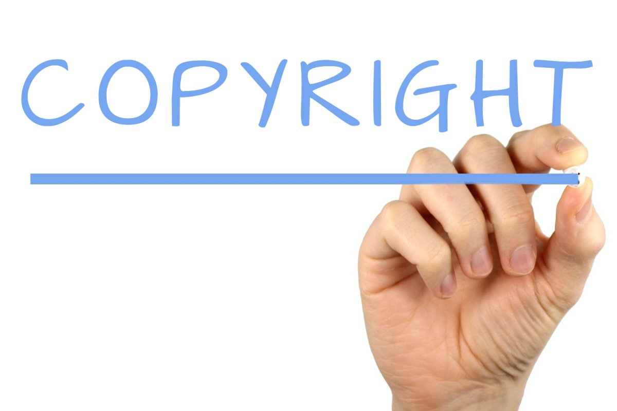 Hand writing the word- Copyright