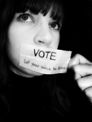 Woman with note saying Vote: Let your voice be heard
