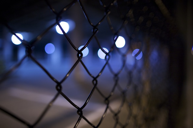 photo of chain link fence at night