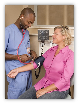 Image: Male nurse taking the blood pressure of a female patient