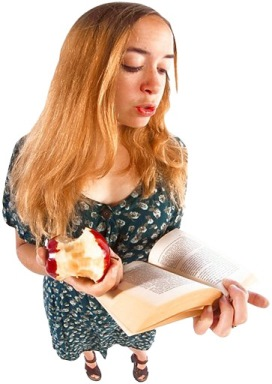 Student Reading book and eating apple