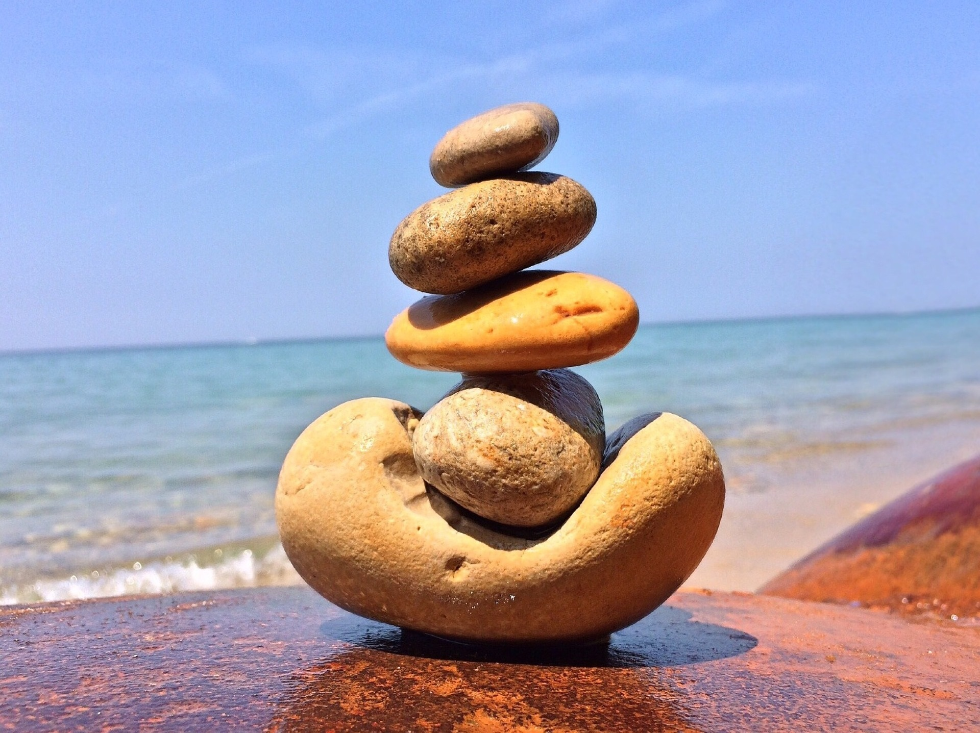balanced stones at the water