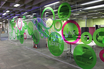 Photograph of the Library Link classroom with green circles on glass