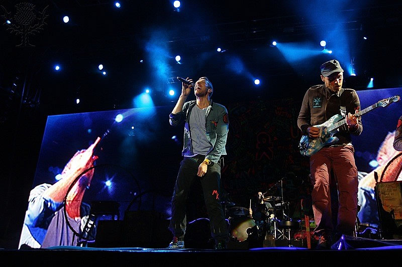 Splendour In The Grass. hris Martin and Jonny Buckland of Coldplay perform on stage.