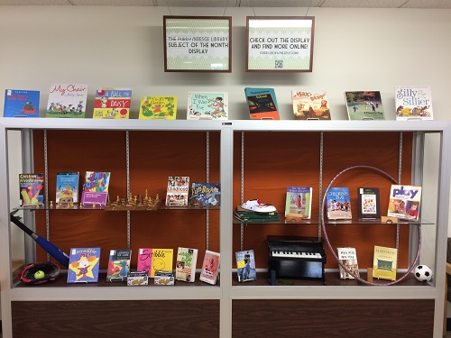 Several books and toys are in the display.