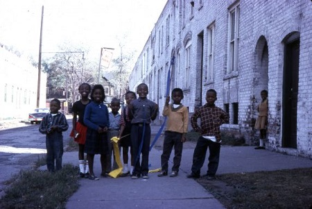 A group of children pose on a Detroit street.