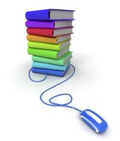 a pile of books, each in a different color of the rainbow and a computer mouse connected to the books via a cord
