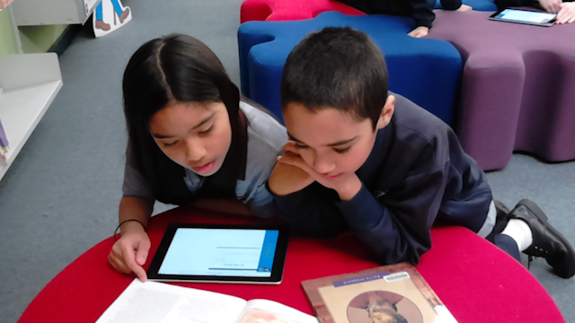 Two students loking at ipad